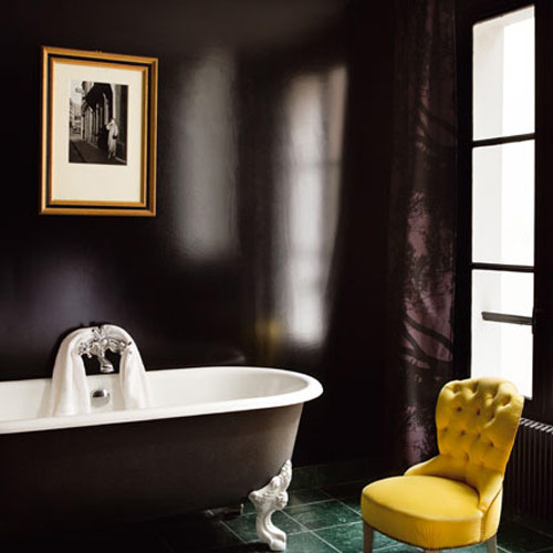 simple yellow accent chair and frame turned this black bathroom ...