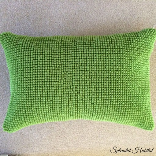green pillow Ikea rug