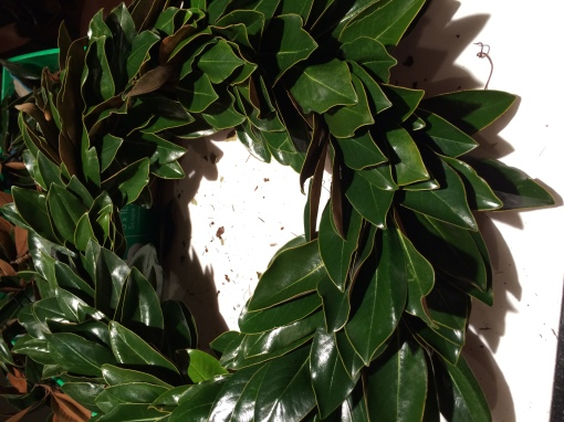 Attach magnolias to wreath form