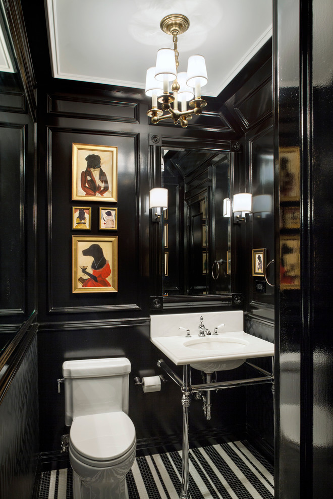Powder room with glossy black walls