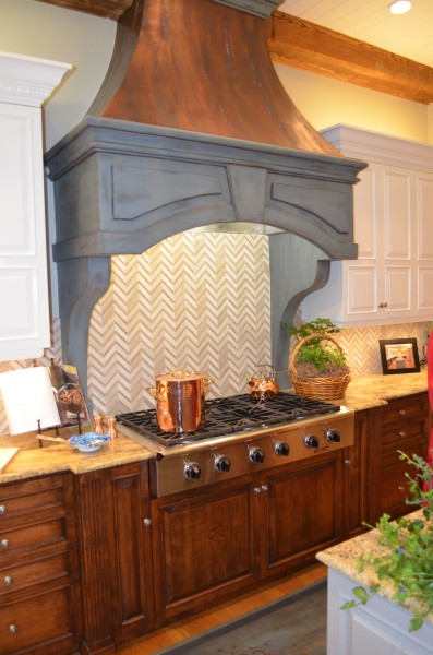 ASO show house kitchen hood faux painted copper